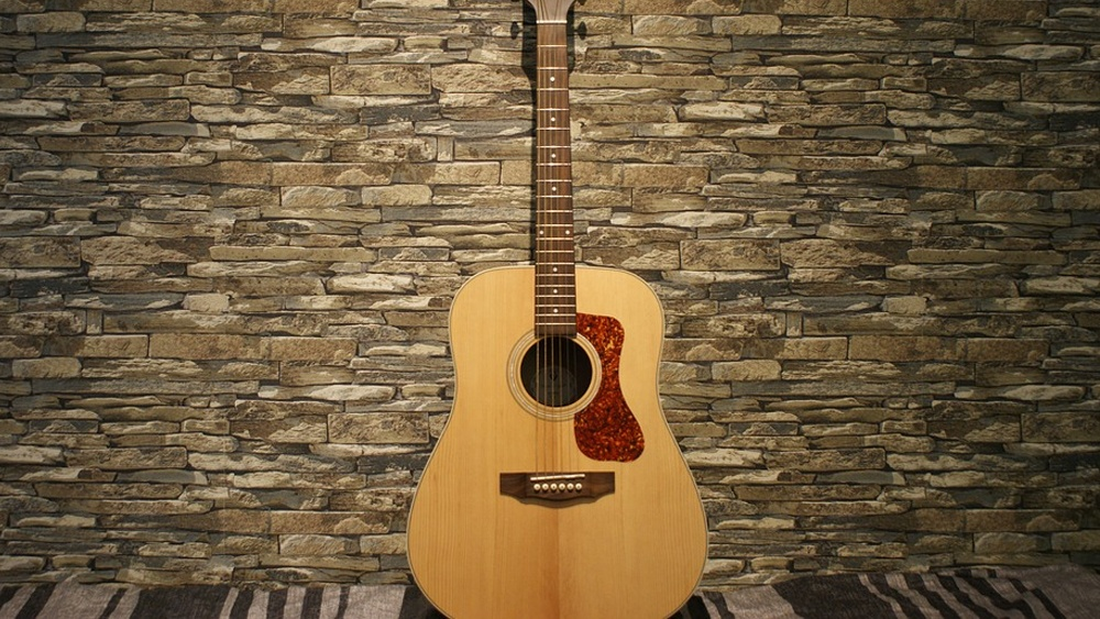 Best acoustic guitars under 1000 dollars featured